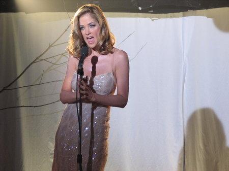 Andie (Kassie DePaiva) sings her final song at the NYC night club Genesis in the short film EXIT, directed by Jamie Duneier.