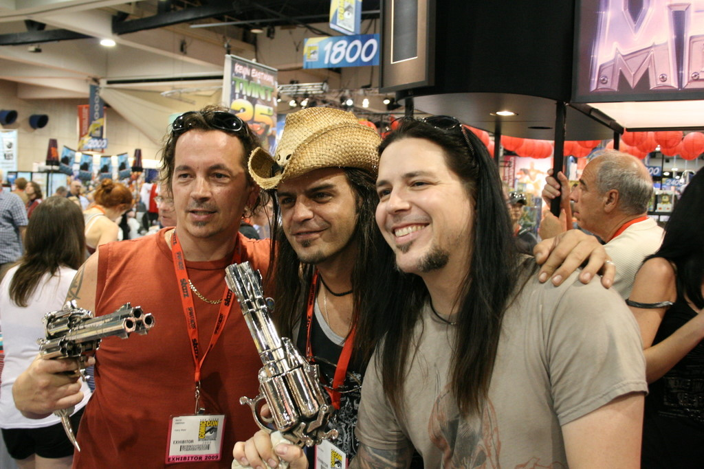 Kevin Eastman and Digger Mesch with prop three-barrel revolvers from Fistful of Blood.