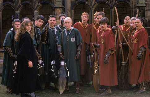 Hermione Granger (EMMA WATSON, left) joins the Quidditch players including Draco Malfoy (TOM FELTON, center) and Harry Potter (DANIEL RADCLIFFE).