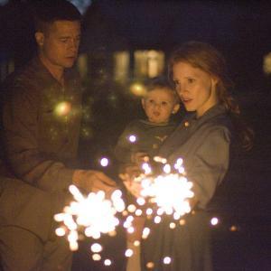 Still of Brad Pitt Jessica Chastain and Laramie Eppler in The Tree of Life 2011