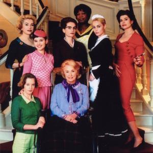 Catherine Deneuve (far left), Virginie Ledoyen (left), Ludivine Sagnier (bottom left), Danielle Darrieux (bottom center), Isabelle Huppert (middle center), Firmine Richard (top center), Emmanuelle Béart (right), and Fanny Ardant (far right).