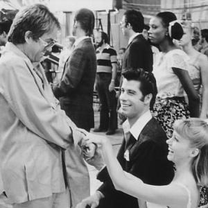 Still of John Travolta, Olivia Newton-John and Allan Carr in Grease (1978)