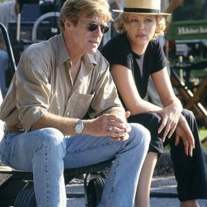 Director Robert Redford with Charlize Theron