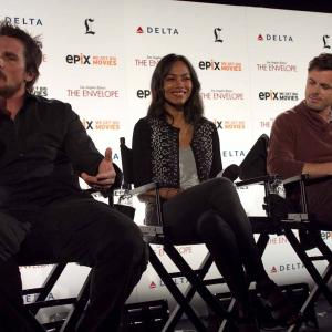 Christian Bale, Casey Affleck and Zoe Saldana at event of Out of the Furnace (2013)