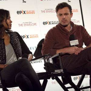 Casey Affleck and Zoe Saldana at event of Out of the Furnace (2013)