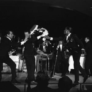 Peter Lawford, Dean Martin, Joey Bishop, Frank Sinatra, Sammy Davis Jr. and Buddy Lester performing in the Copa Room at the Sands Hotel in Las Vegas