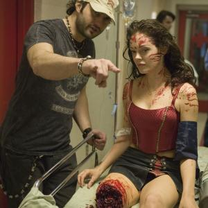 Still of Rose McGowan and Robert Rodriguez in Grindhouse 2007