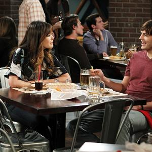 Still of Ashton Kutcher and Lindsay Price in Two and a Half Men (2003)