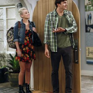 Still of Ashton Kutcher and Miley Cyrus in Two and a Half Men (2003)