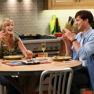 Still of Ashton Kutcher and Courtney Thorne-Smith in Two and a Half Men (2003)
