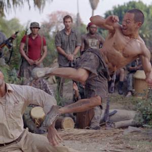 The Rock fights Ernie Reyes Jr as Seann William Scott looks on