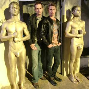 Casper Andreas (Nick) and Matthew Ludwinski (Adam) with Golden Statues on the set of