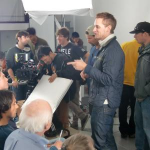 Director Casper Andreas with cast and crew on the set of