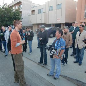 Casper Andreas directs paparazzi on the set of