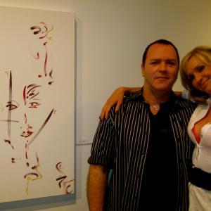 Christopher Ciccone Madonnas brotherartist  Karen Campbell MTV VJ  his art exhibit Beverly Hills