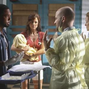 Still of Jason George, Leslie Hope, Todd Louiso and Valerie Cruz in Off the Map (2011)