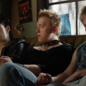 Still of Justin Bartha and Rupert Grint in CBGB (2013)