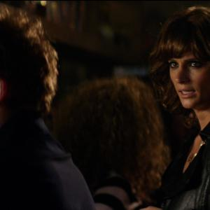 Still of Rupert Grint and Stana Katic in CBGB (2013)
