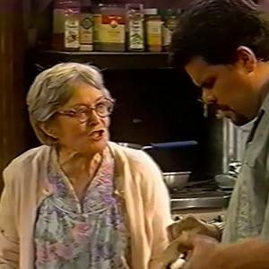 Eve Brenner as Mrs. Gallagher (with Luis Guzman) on