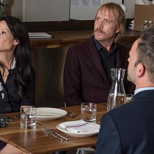 Still of Jonny Lee Miller Lucy Liu and Rhys Ifans in Elementaru 2012