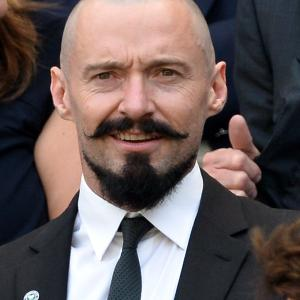Hugh Jackman attends the Julia Glushko v Sabine Lisicki match on centre court during day two of the Wimbledon Championships at Wimbledon on June 24, 2014 in London, England.