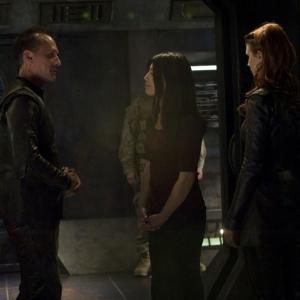 Still of Ming-Na Wen, Robert Knepper and Julie McNiven in SGU Stargate Universe (2009)