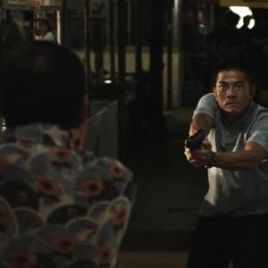 Still of Aaron Kwok in B+ jing taam (2011)