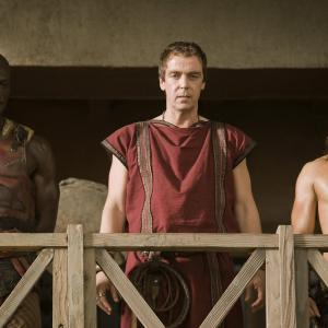 Still of John Hannah, Peter Mensah and Dustin Clare in Spartacus: Gods of the Arena: Paterfamilias (2011)