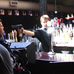 The Bartender Douglas Kidd points his gun at Don Matthew Stefiuk in a scene from Donkey 2010