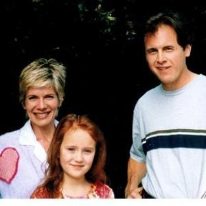 Aria Curzon as Janie with Mark Moses and Debbie Boone as Mr. & Mrs. Taylor on the set of Treehouse Hostage.