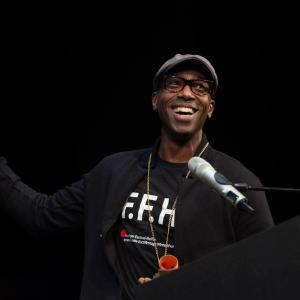Ntare Guma Mbaho Mwine takes selfie while accepting award for his short film KUHANI at the Internationale Kurzfilmtage Winterthur in Switzerland