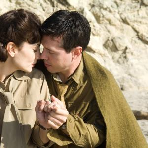 Still of Annie Parisse and Jon Seda in The Pacific 2010