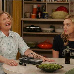 THAT '70s SHOW: Kitty (Debra Jo Rupp, L) and Donna (Laura Prepon, R) make a tape in the one-hour season premier episode of THAT '70s SHOW