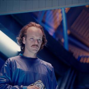 Still of Peter Sarsgaard in Zaliasis zibintas 3D (2011)