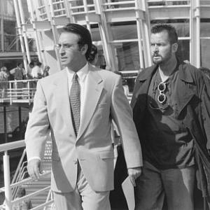 Still of Charlie Sheen and Ron Silver in The Arrival (1996)