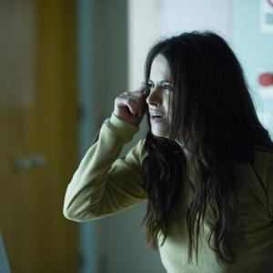 Still of Emily Hampshire and Aaron Stanford in 12 Monkeys 2015