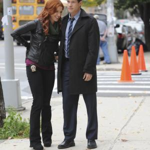 Still of Poppy Montgomery and Dylan Walsh in Unforgettable 2011