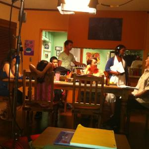 On the set of Strike One during family dinner  Standing AJ Winslow and Liz Edwards seated are Kyara Campos Maris Isa Johnny Ortiz Alma Martinez and Danny Trejo