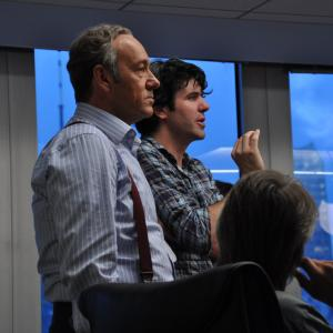 Writer/Director J.C. Chandor on the set of Margin Call with actors Kevin Spacey and Jeremy Irons