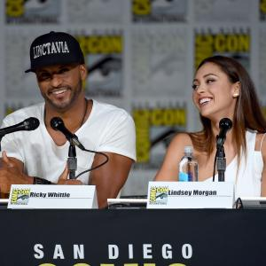 Ricky Whittle and Lindsey Morgan at event of The 100 2014