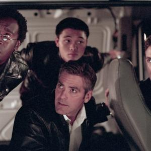 Still of George Clooney, Don Cheadle and Casey Affleck in Ocean's Eleven (2001)