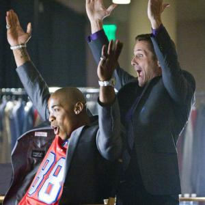 Still of Rob Estes and Mehcad Brooks in Necessary Roughness (2011)