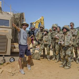 David Sant on the set of Bluestone 42 with the cast.