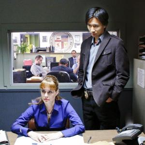 Roy as Detective Lee with Stephanie Erb as Detective Gaines in