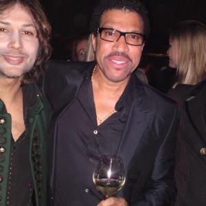 Edward Bass, Lionel Richie, and Cyrus Pahlavi.