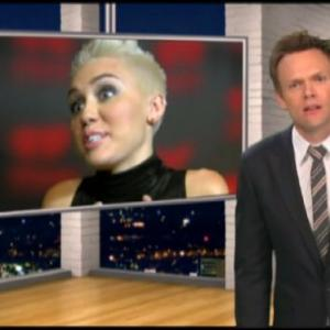 Still of Joel McHale, Miley Cyrus and Lou the Chihuahua in The Soup (2004)