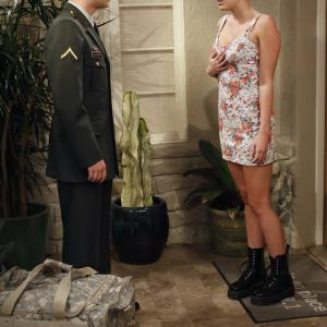 Still of Angus T. Jones and Miley Cyrus in Two and a Half Men (2003)