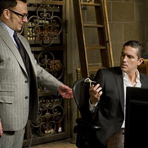 Still of Jim Caviezel and Michael Emerson in Person of Interest: Many Happy Returns (2012)