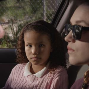 Tia (played by Alessandra Shelby Farmer) gets a ride to school from her new stepsister Carrie (played by Kerry Knuppe) in independent thriller HOME.