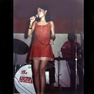 This is the earliest recorded photo of Shere sing in Saigon Vietnam 1972. Singing in her brothers band called the Mavricks.